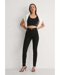 Calvin Klein Hochgeschnittene Skinny Knöchel-Jeans - Schwarz