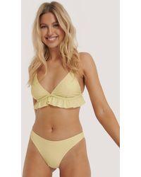 NA-KD Swimwear Hoog Uitgesneden Bikinibroekje - Geel