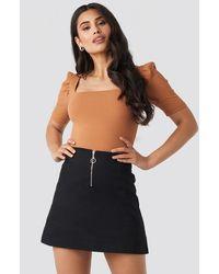 NA-KD Ring Puller A-Line Mini Skirt - Schwarz