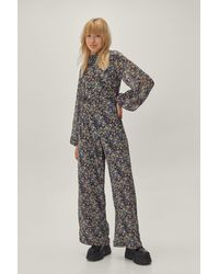 Nasty Gal Ditsy floral puff sleeve high neck jumpsuit - Bleu