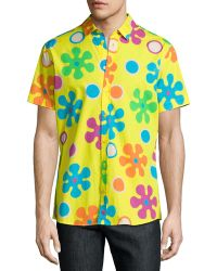 shop men s moschino clothing from 29 lyst moschino psychedelic floral print short sleeve sport shirt lyst
