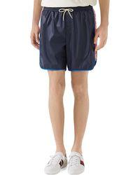 ea433ae41b Gucci Monogram Swim Shorts in Blue for Men - Lyst