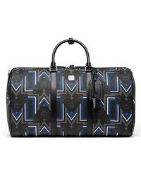 MCM - Gunta Logo-print Weekender Bag - Lyst