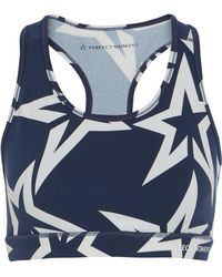 Perfect Moment - Star Printed Stretch-jersey Sports Bra - Lyst