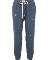 The Great - The Cropped Embroidered Cotton-jersey Track Pants - Lyst
