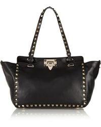 Valentino - Garavani The Rockstud Small Leather Trapeze Bag - Lyst