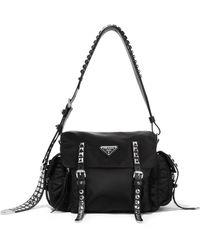 2fafe39222 Prada - Studded Leather-trimmed Shell Shoulder Bag - Lyst