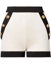 Balmain - Button-embellished Two-tone Stretch-knit Shorts - Lyst