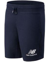 New Balance Hombres Pantalones cortos NB Essentials Stacked Logo - Azul