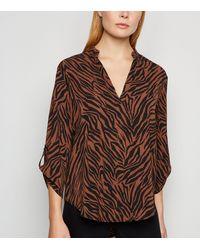 Apricot Rust Zebra Print Dip Hem Shirt - Brown