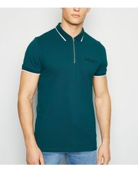 527289f3d Teal Tipped Zip Front Polo Shirt - Blue