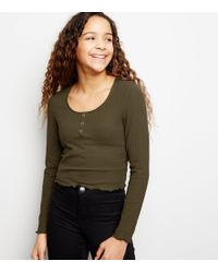 9a97deb52f88a9 New Look - Girls Khaki Ribbed Popper Front Long Sleeve Top - Lyst