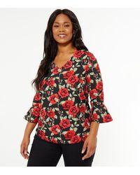 Mela Curves Black Rose Flared Sleeve Top