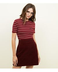 93b6f62845 New Look Burgundy Snake Print Denim Skirt in Red - Lyst