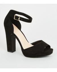 57e731fab3 New Look Wide Fit Black Suedette Cross Strap Platform Heels in Black ...