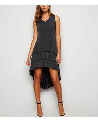 Mela Black Shimmer Ruffle Dip Hem Dress - Metallic