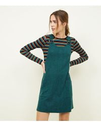 52f8484378 New Look - Dark Green Round Buckle Pinafore Dress - Lyst