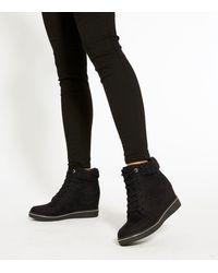 New Look Black Faux Fleece Cuff Wedge Heel Trainers