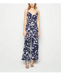 Mela Navy Floral Jumpsuit - Blue