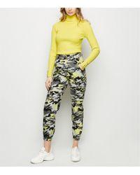 New Look Yellow Neon Camo Print Cuffed Utility Trousers