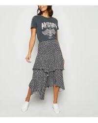 New Look Black Ditsy Floral Hanky Hem Midi Skirt