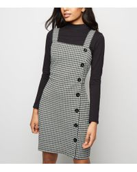 76979c97838 New Look - Petite Black Gingham Button Side Pinafore Dress - Lyst