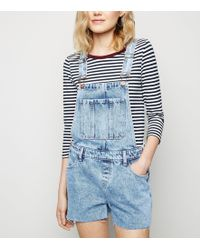 8de425bea2 TOPSHOP Moto Acid Wash Denim Playsuit in Blue - Lyst