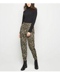 0f5d8fa623ce New Look - Khaki Leopard Print Joggers - Lyst