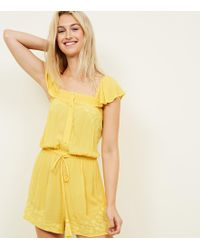 e7eb49da991 New Look - Mustard Floral Embroidered Tassel Tie Playsuit - Lyst