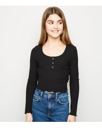 3b87ec7c237a82 New Look - Girls Black Ribbed Popper Front Long Sleeve Top - Lyst