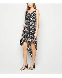Mela - Black Floral Dip Hem Dress - Lyst