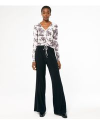 New Look Tall Black Ribbed Jersey Flared Trousers