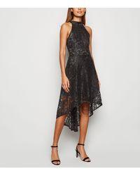 Mela Black Lace Dip Hem Halter Neck Dress