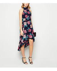 Mela - Navy Floral High Neck Dip Hem Dress - Lyst