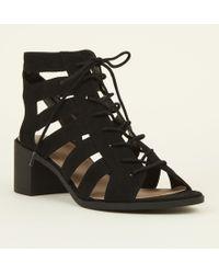 c05b9afbf4690 New Look Black Suedette Lace Up Peep Toe Ghillie Heels in Black - Lyst