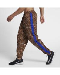 Nike Track pants Repel - Metallizzato