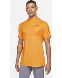 Nike Maglia da golf a manica corta con collo a lupetto Dri-FIT Tiger Woods - Arancione