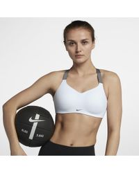 13a42fac10 Lyst - Nike Seamless Women s Light Support Sports Bra in White