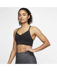 Nike Indy gepolsterter, nahtloser Sport-BH mit leichtem Halt - Schwarz