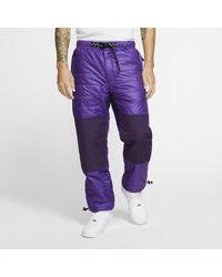 Nike - Pantaloni trail ACG Primaloft® - Lyst