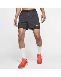 Nike Flex Stride 2-in-1-Laufshorts - Schwarz