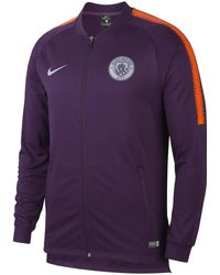 14bbb34de43fe nike-Purple-Manchester-City-Fc-Dri-fit-Squad-Football-Track-Jacket.jpeg