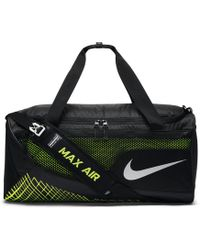 10baeea5789a Lyst - Nike Team Training Max Air Id Duffel Bag (medium) (yellow) in ...