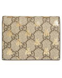 6b84f57d7b4 Lyst - Gucci Gg Supreme Appliquéd-Face Flap Wallet in Natural
