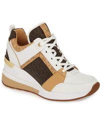 a7780306476 Lyst - MICHAEL Michael Kors Georgie Wedge Sneaker in White
