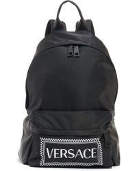 6f55d3ba5e Versace Palazzo Mini Nylon Backpack in Black - Lyst