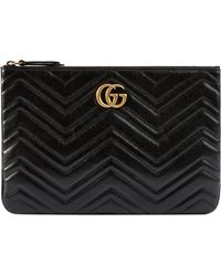 9cbc3b62d0e Lyst - Gucci Gg Marmont Animal Studs Leather Pouch in Black