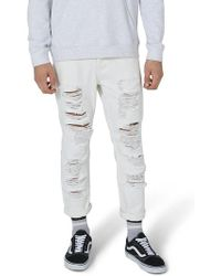 TOPMAN - Extreme Ripped Tapered Fit Jeans - Lyst