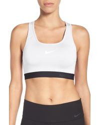 f437524d0a22d Lyst - Nike  pro - Fierce  Dri-fit Sports Bra in Black