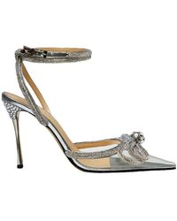 Mach & Mach Double Crystal Bow Transparent Pointed Toe Pump - Metallic